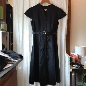 Black dress with short sleeves and belt.